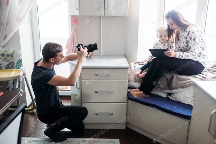 Thumbnail for Father taking photo of his daughter and wife