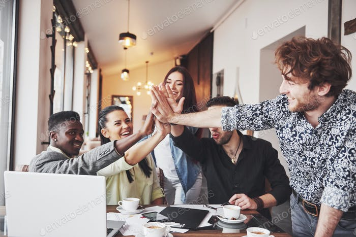 business office people giving high fives to each other as if celebrating success