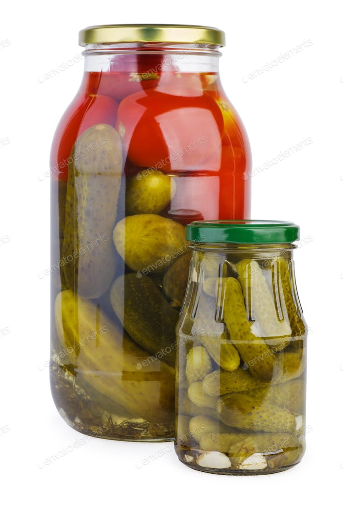 Glass jars with pickled tomatoes and cucumbers
