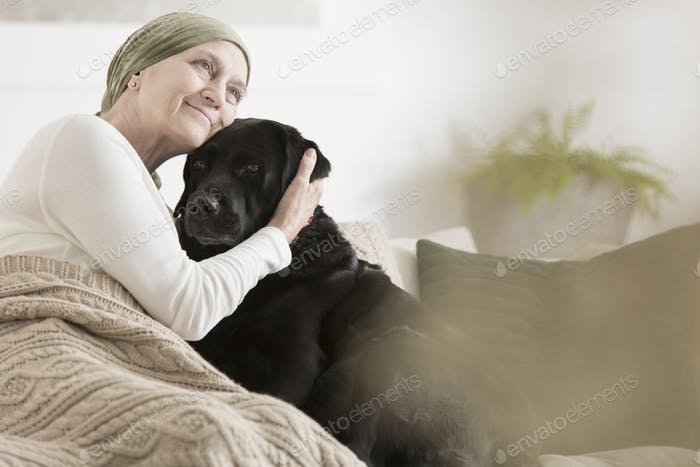 Sick woman hugging her pet