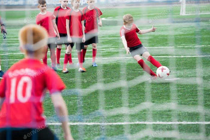 Boy Scoring Goal