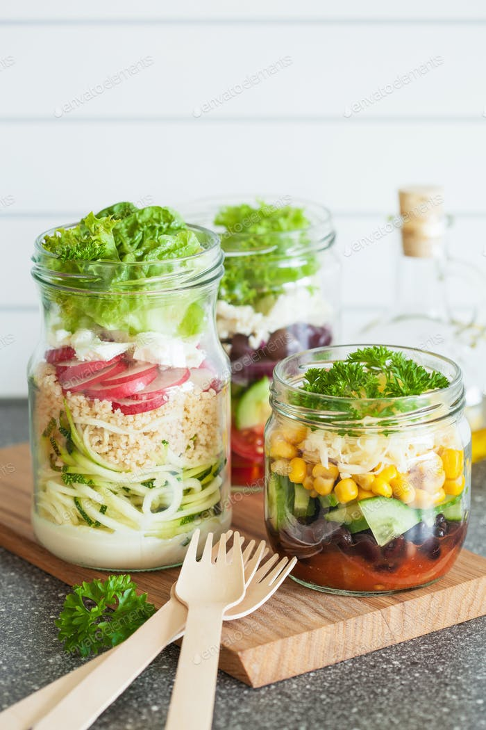 healthy vegetable and cheese salad in mason jars