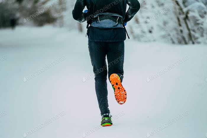 Man Running in Winter Woods