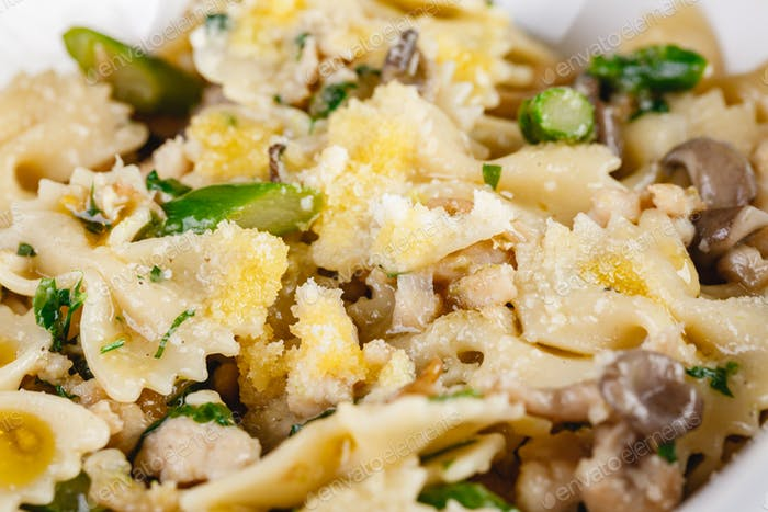 Farfalle pasta with champignon mushrooms asparagus and garlic creamy sauce