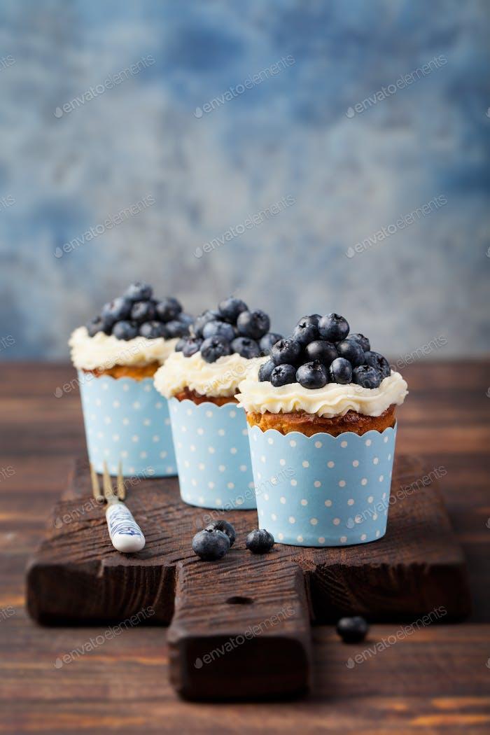 Pumpkin cupcakes with cream cheese, blueberries