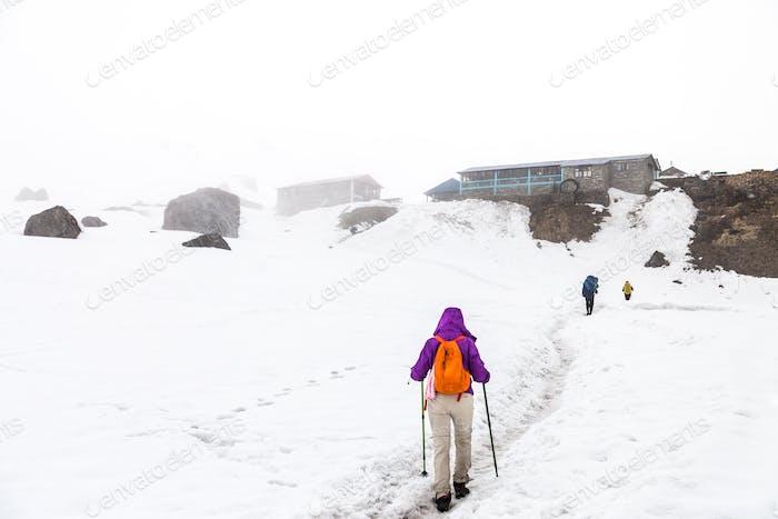 Female hiking on snow trail towards Annapurna base camp, Nepal