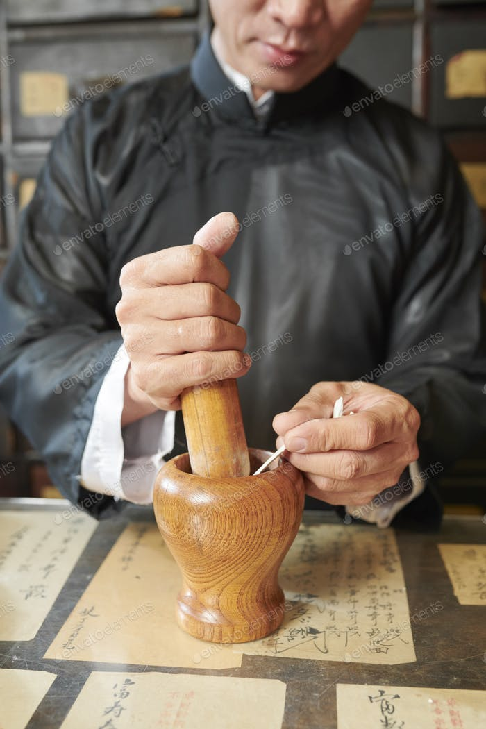 Apothecary worker making medicine