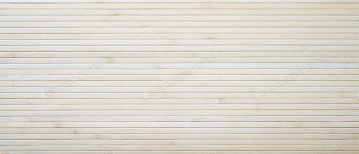 Natural authentic mat of horisontal bamboo texture striped background