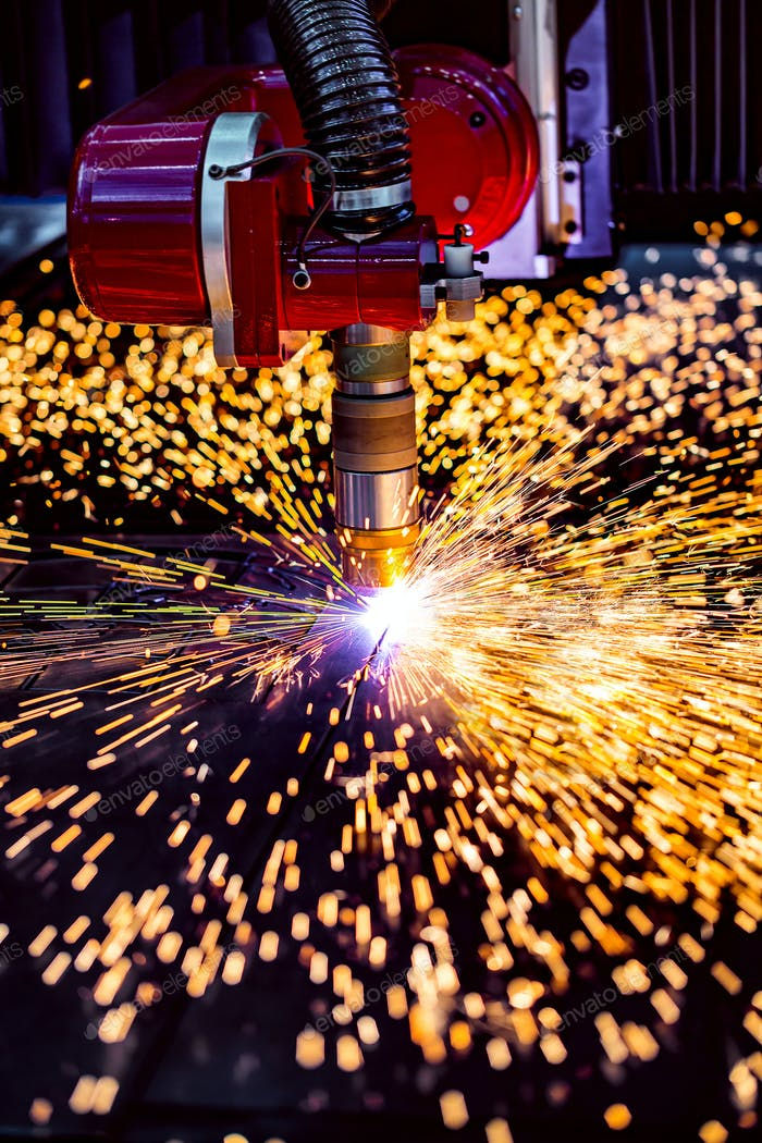 CNC Laser plasma cutting of metal, modern industrial technology.