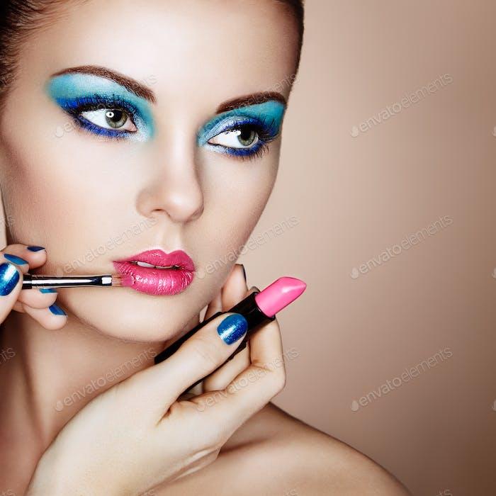 Thumbnail for Makeup artist applies lipstick