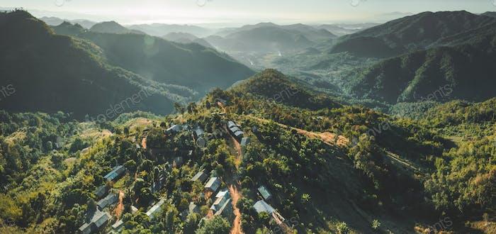 Settlement among Thailand wild nature. Aerial shot