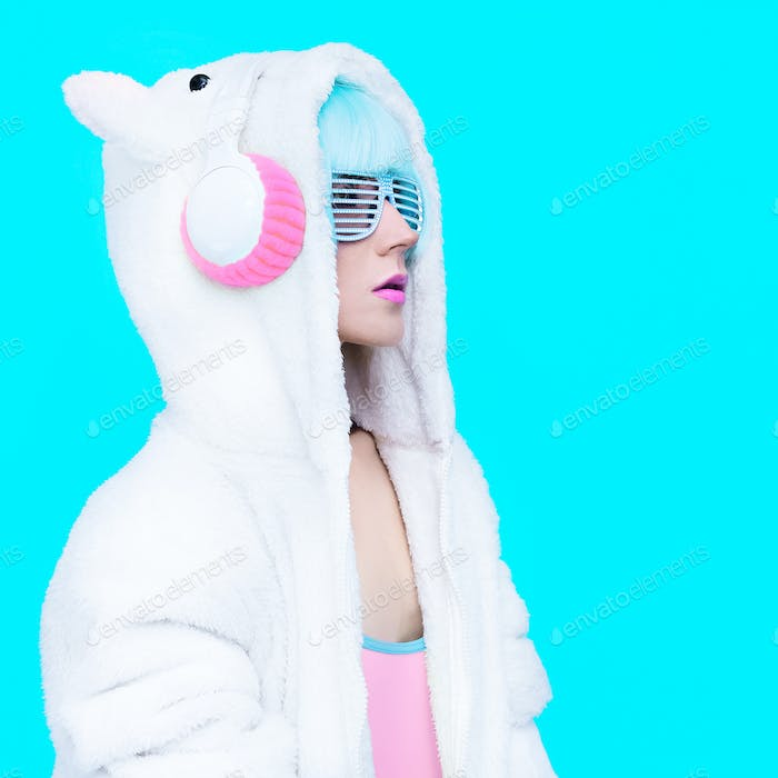 fashion teddy bear girl on a blue background. DJ and club winter