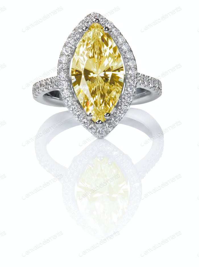 Fancy Yellow Beautiful Diamond Engagement ring. Gemstone Marquise cut surrounded by halo diamonds.
