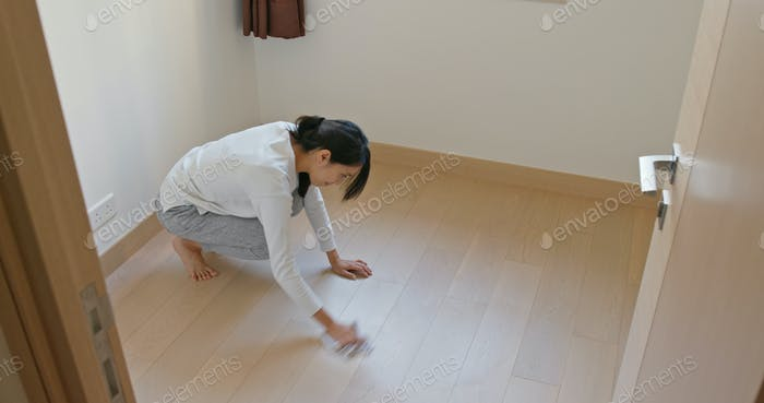 Woman clean the floor at home