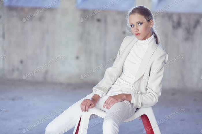 Blue eyes girl in a white clothes.