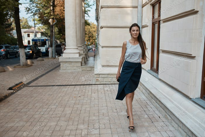 Fashion pretty woman walking through the streets of Old City