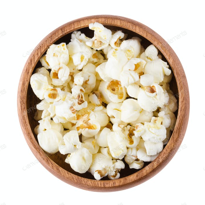 Popped popcorn in a bowl over white