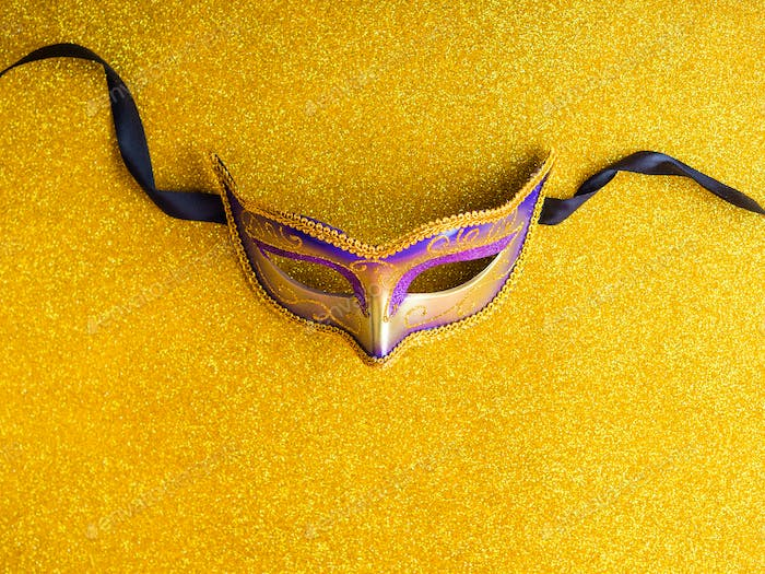 Carnival mardi gras party mask on gold background