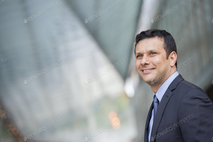 A latino businessman in business clothes.