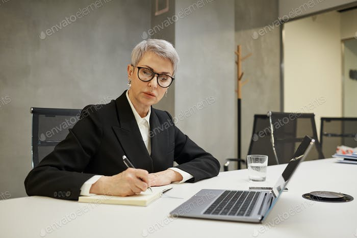 Successful Mature Businesswoman at Desk
