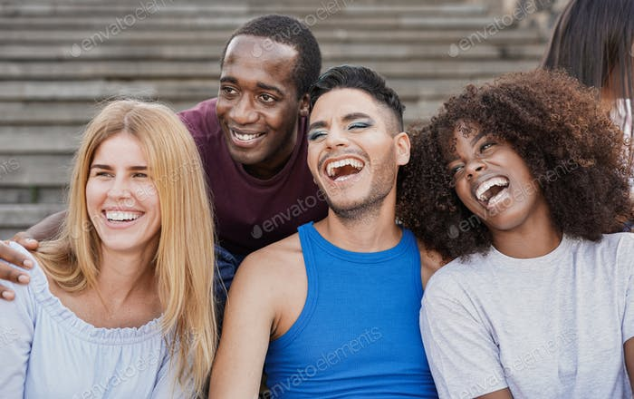 Group of multiracial people taking a selfie in the city - Diverse people and friendship concept