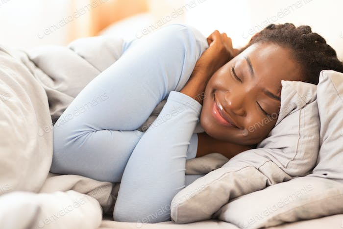 Asleep African American Lady Lying In Bed At Home