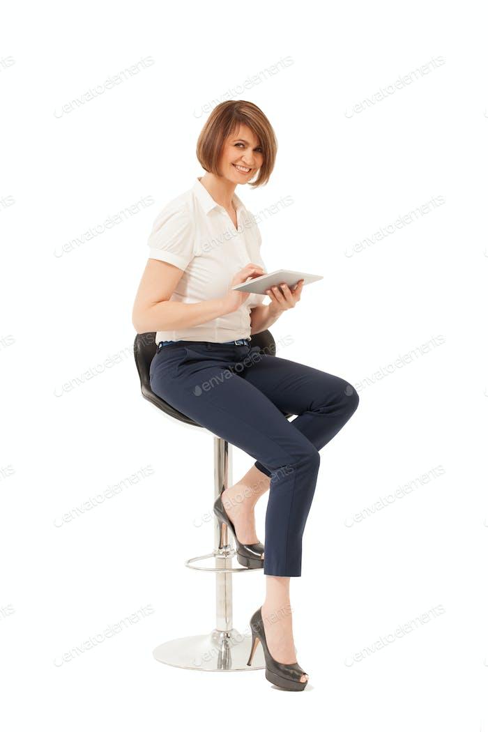 Elegant smiling woman holding tablet