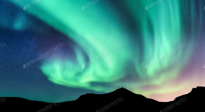 Aurora borealis and silhouette of mountains