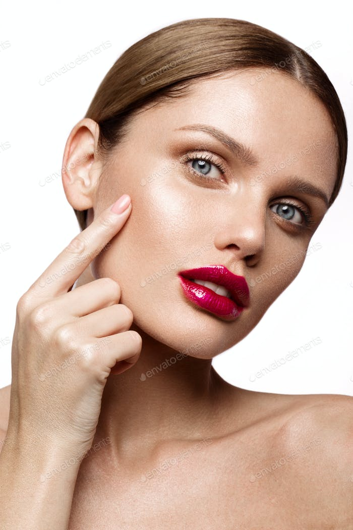 Beautiful young model with red lips isoleted on a wight background