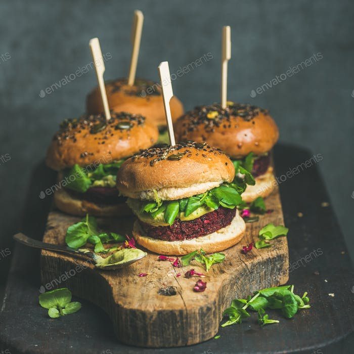 Healthy homemade vegan burger with beetroot-quinoa patty and arugula