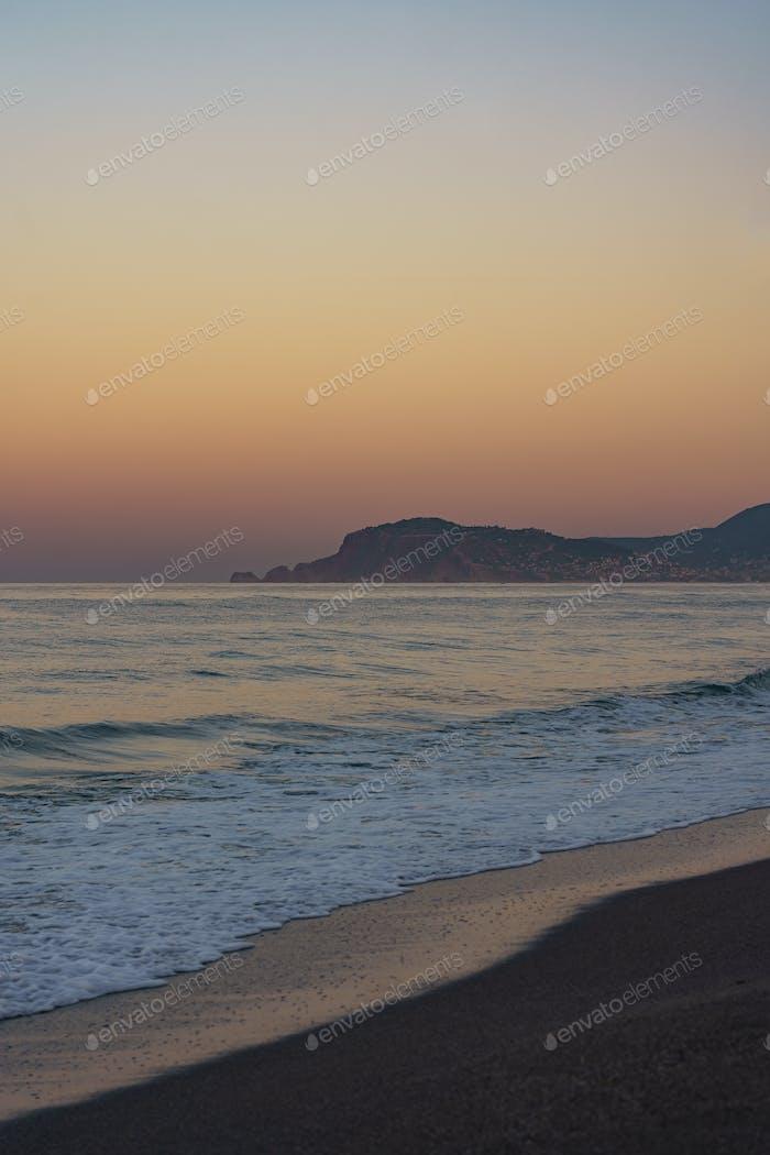 Sunset on sea coastline