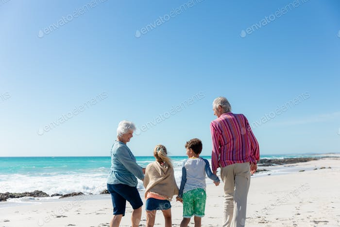 Grandparents and grandchildren at the beach
