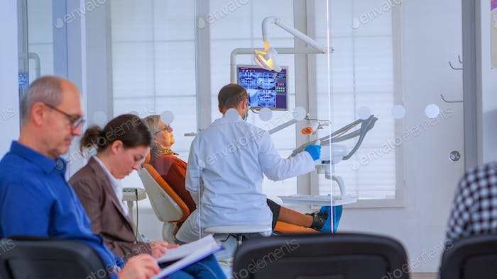 Dentist doctor working in crowded office