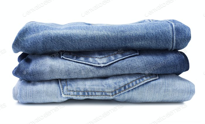 Stack of blue jeans isolated on white