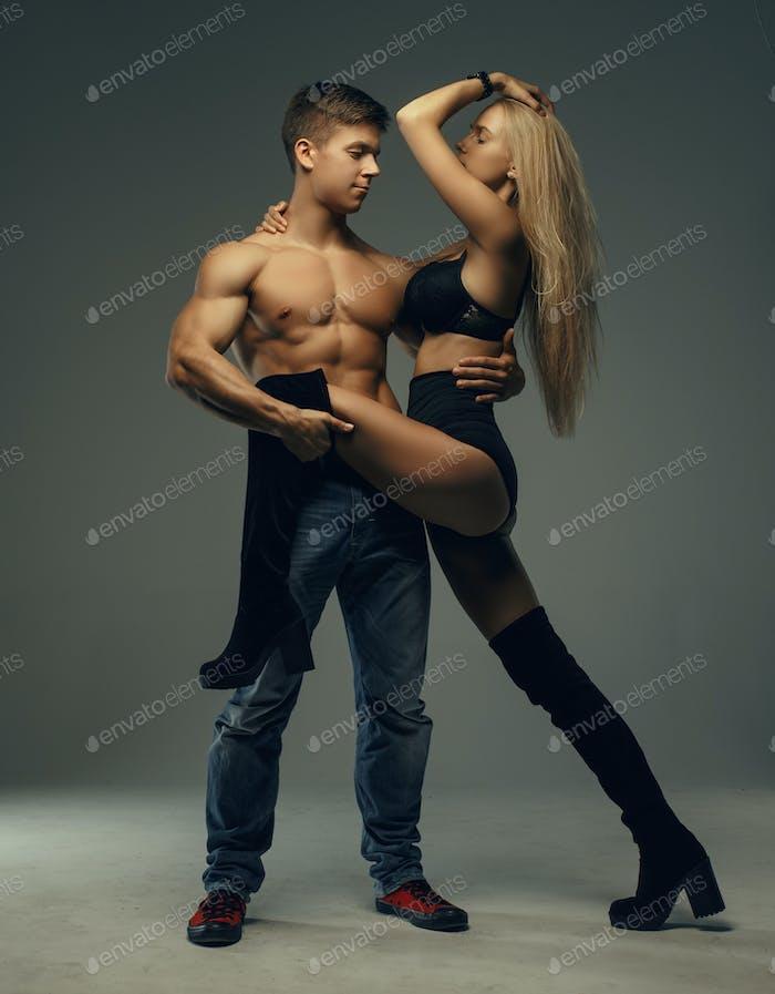 Man holding long leg of his woman.