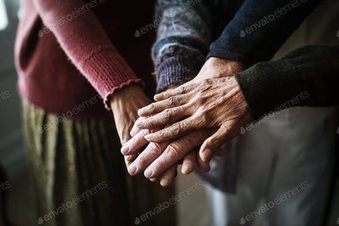 Closeup of hands of group of seniors