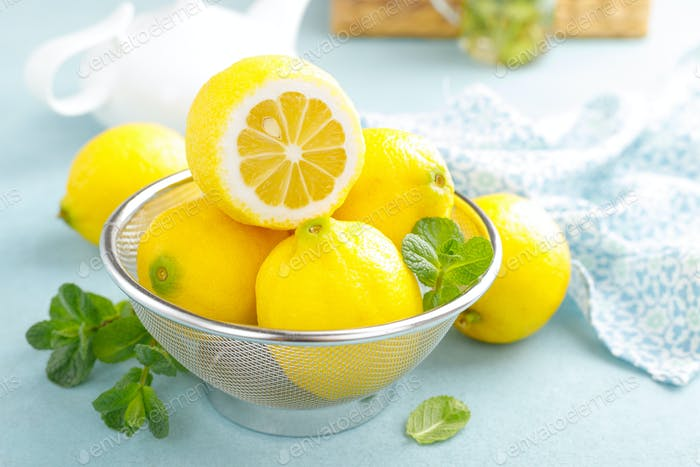 Sliced and whole lemons with mint