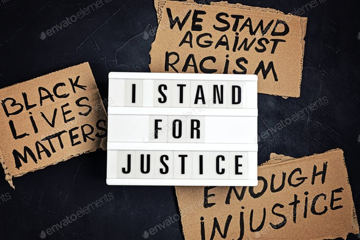 I stand for justice text on light box and other anti racism slogans