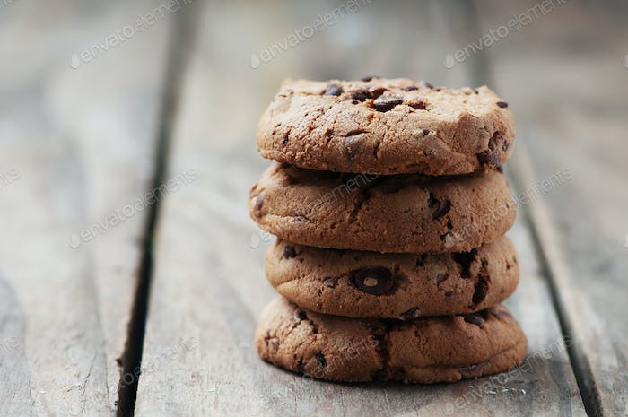 Cookie with chocolate on the wooden table