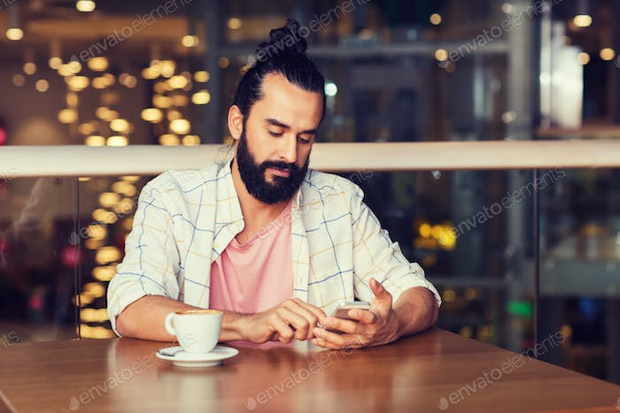 man with smartphone and coffee at restaurant