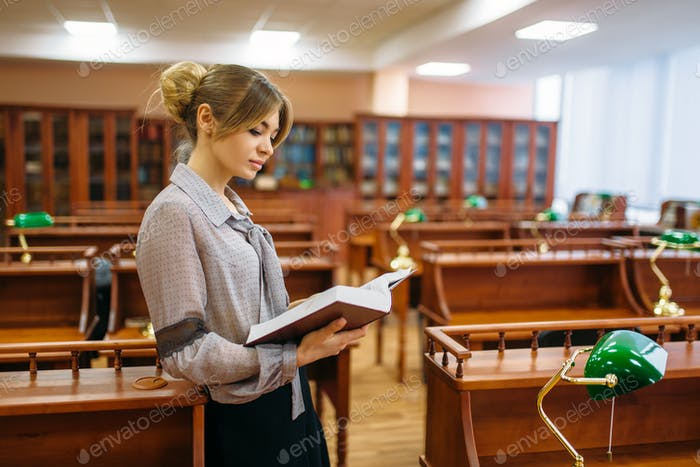 Young woman in reading room, university library