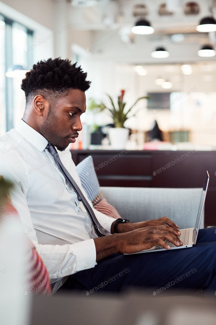 Thumbnail for Businessman Working On Laptop At Desk In Shared Workspace Office
