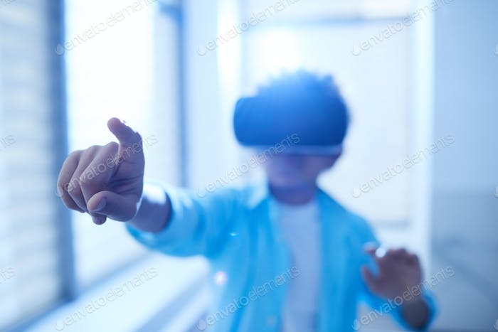 Unrecognizable Boy In VR Headset