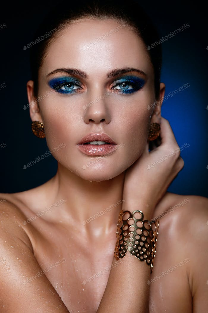 Young woman with bright makeup