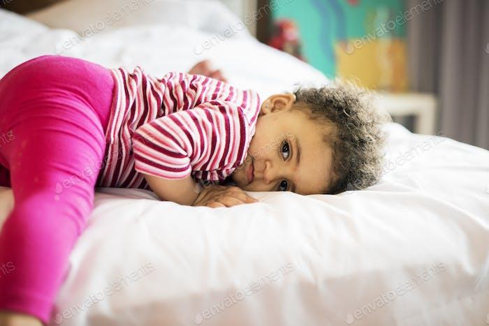 Brazilian toddler girl on bed