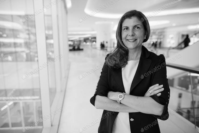 Portrait of mature businesswoman around the city