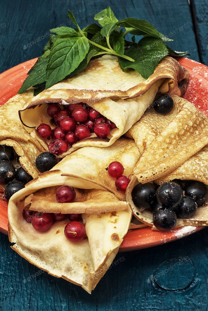 home-made pancakes stuffed with red and black currants