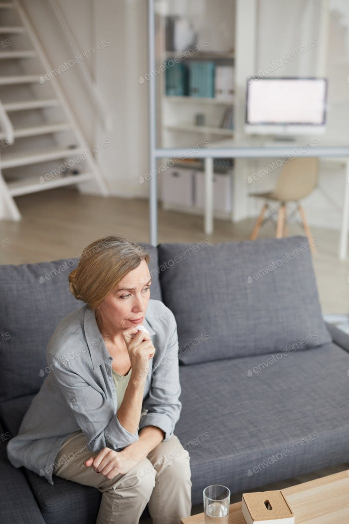 Pensive Mature Woman Crying at Home