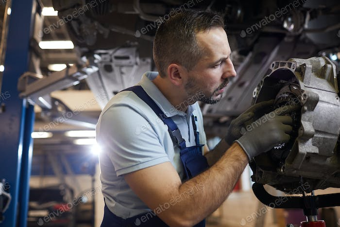 Mechanic Repairing Car in Auto Shop