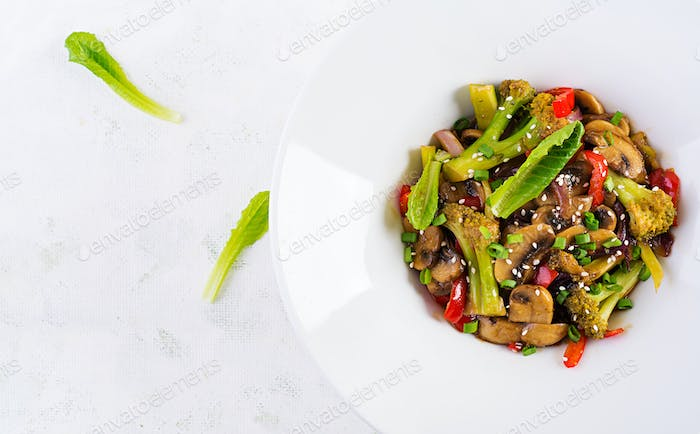 Stir fry vegetables with mushrooms, paprika, red onions and broccoli.